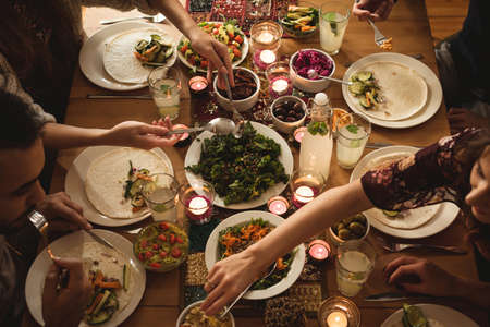 High angle view of friends having meal at table