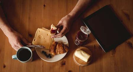 Overhead of man having breakfast in kitchen LANG_EVOIMAGES
