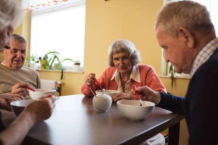 Senior friends having breakfast together at nursing home