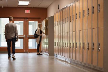 University students walking in corridor of university LANG_EVOIMAGES