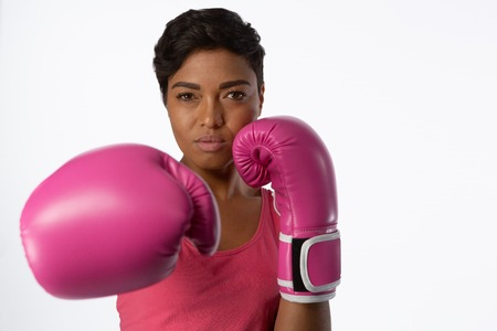 Boxing woman for breast cancer awareness on white background Stock Photo