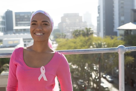 Smiling women with cancer over the city