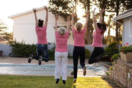 Women standing up to breast cancer on a sunny day