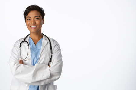 Smiling confident female doctor with crossed arms on a white background Stock Photo