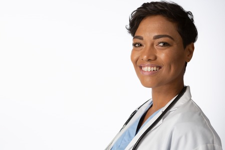 Smiling female doctor wearing a lab coat on a white background