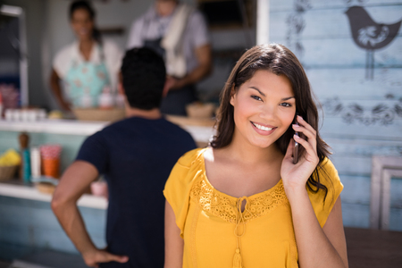 Portrait of smiling woman talking on mobile phone