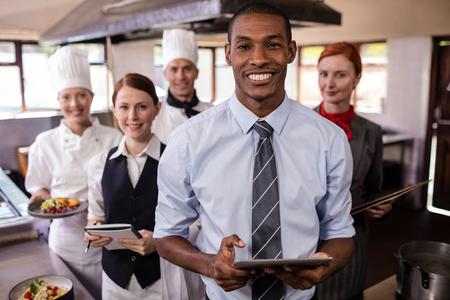 Group of hotel staffs working in kitchen at hotel