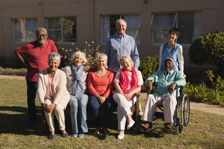 Portrait of active and diverse group of senior people posing in the park