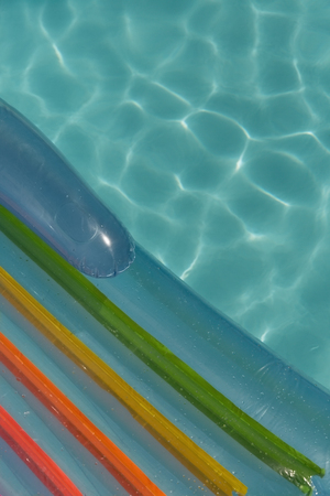 Inflatable tube floating in a swimming pool on a sunny day 写真素材