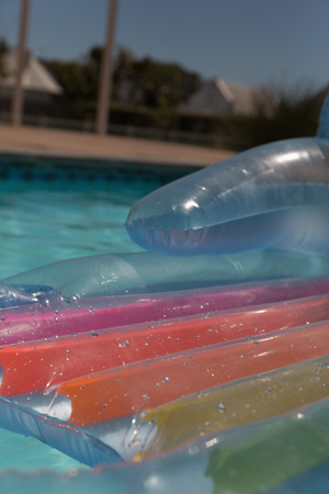 Inflatable tube floating in a swimming pool on a sunny day Imagens