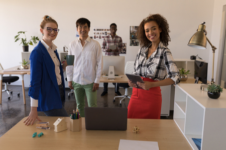 Portrait of young diverse business colleagues standing together in modern office Stok Fotoğraf - 122297274