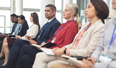 Side view of diverse business people looking serious while attending a business seminar in office building Stok Fotoğraf - 122297213