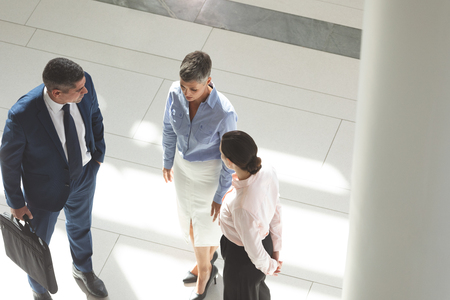 High angle view of diverse business people interacting with each other in lobby office Stok Fotoğraf