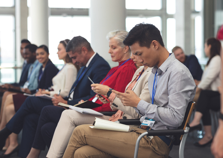 Side view of diverse business people attending a business seminar in modern office building Stok Fotoğraf - 122296811