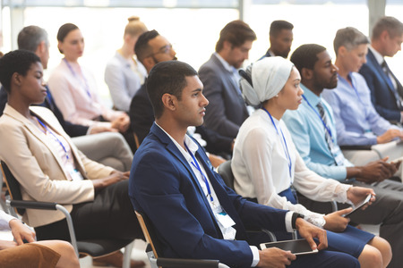 Side view of diverse business people attending a business seminar in office building Stok Fotoğraf - 122297157