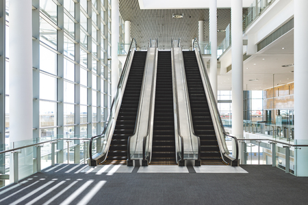Front view of escalators in an empty modern office building Stok Fotoğraf - 122297168