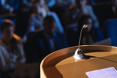 Close up of podium with speaker in auditorium Reklamní fotografie