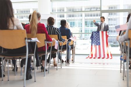 Front view of Caucasian male speaker speaks in a business seminar in office building