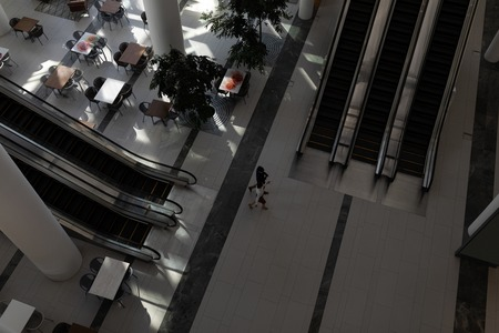 High angle view of business executives walking together in modern office lobby Фото со стока