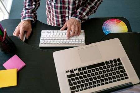 Closed-up of Caucasian male graphic designer working on laptop at desk in office Stock Photo - 124673115