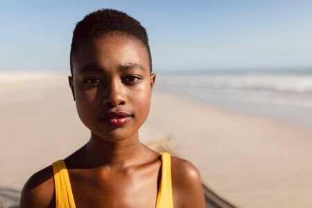 Portrait of young African-american woman standing on the beach