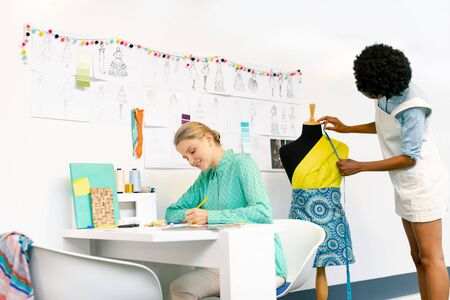 Side view of diverse female graphic designers working in office