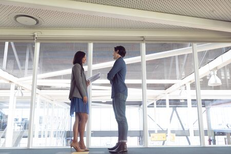Low angle view of diverse male and female architects interacting with each other in office