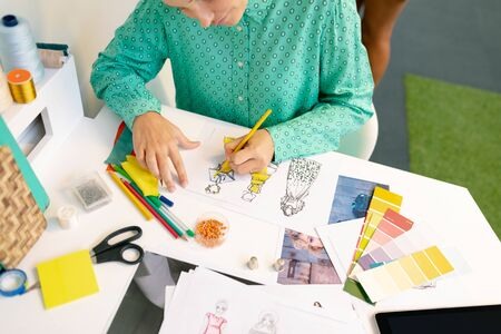 Mid section of Caucasian female graphic designer drawing a sketch in office Stock Photo - 124672296