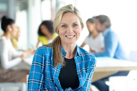 Portait of beautiful Caucasian businesswoman looking at camera in a modern office