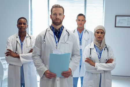 Portrait of medical diverse team standing together in hospital