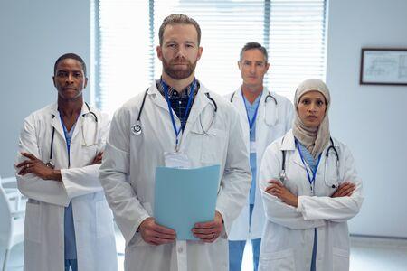 Portrait of medical diverse team standing together in hospital