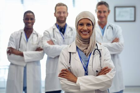 Portrait of medical diverse team standing with arm crossed at hospital