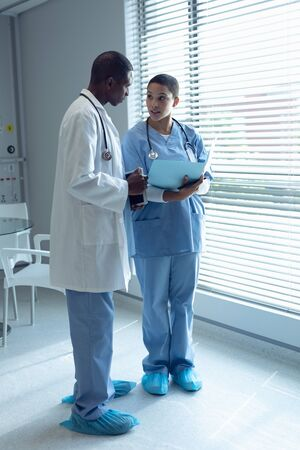 Side view of African american male and female doctors interacting with each other in the hospitalMale and female doctors interacting with each other in the hospital