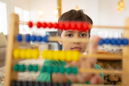 Close-up of African american boy learning mathematics with abacus in a comfortable home Stock fotó