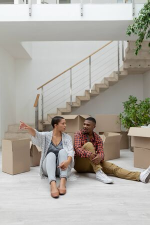 Front view of happy African american couple interacting with each other in living room at home