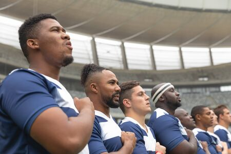 Portrait of group of diverse male rugby players taking pledge together in stadium Stock Photo