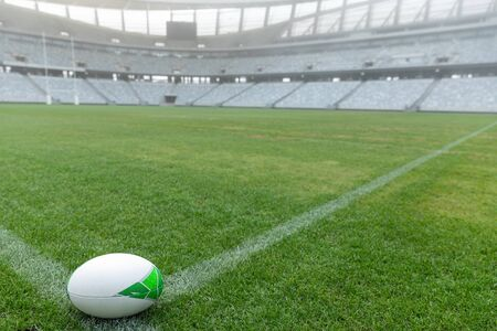 Close-up of Rugby ball on a grass in the empty stadium Banco de Imagens