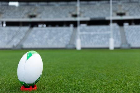 Close-up of Rugby ball on a stand in stadium