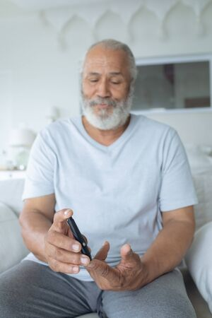 Close up of senior Caucasian man using an insulin pen. Authentic Senior Retired Life Concept
