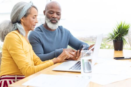Side view of African American Couple calculating finances. Authentic Senior Retired Life Concept 免版税图像