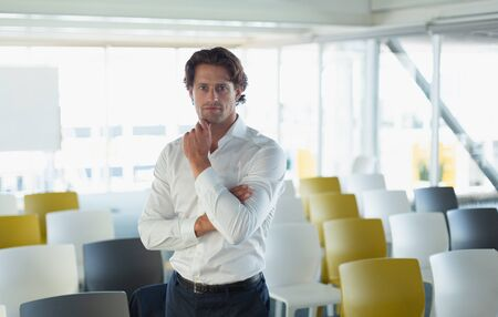 Portrait of handsome young Caucasian businessman in the conference at modern office 写真素材