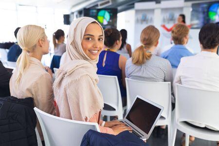 Portrait of happy caucasian Businesswoman using laptop during business seminar . International diverse corporate business partnership concept Banque d'images