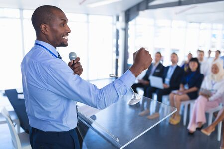 Side view of caucasian Male speaker speaks in business seminar at conference meeting. International diverse corporate business partnership concept