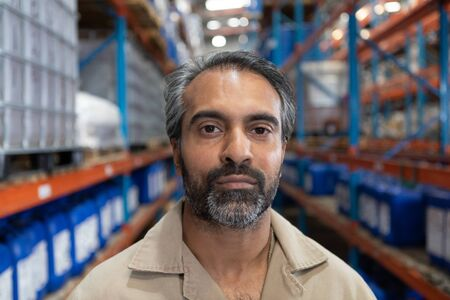 Close-up of male staff looking at camera in warehouse. This is a freight transportation and distribution warehouse. Industrial and industrial workers concept Reklamní fotografie