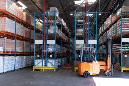 Goods and materials arranged on a rack in warehouse. This is a freight transportation and distribution warehouse. Industrial and industrial workers concept