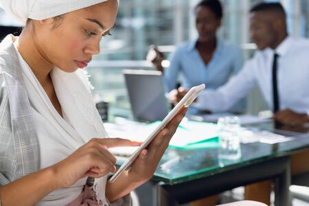 Close-up of Businesswoman in hijab using digital tablet at desk. Modern corporate start up new business concept with entrepreneur working hard