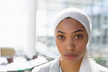Close-up of businesswoman in hijab looking at camera in a modern office. Modern corporate start up new business concept with entrepreneur working hard