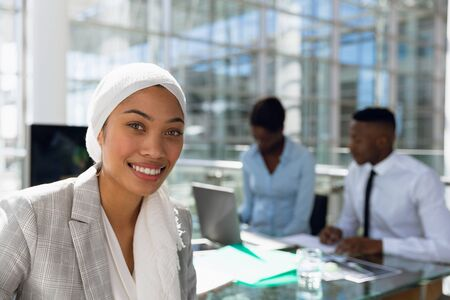 Close-up of happy Businesswoman sitting at desk in office. Modern corporate start up new business concept with entrepreneur working hard Stock fotó