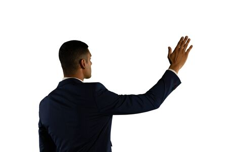 Back view close up of a young mixed race businessman with his arm raised and hand outstretched touching