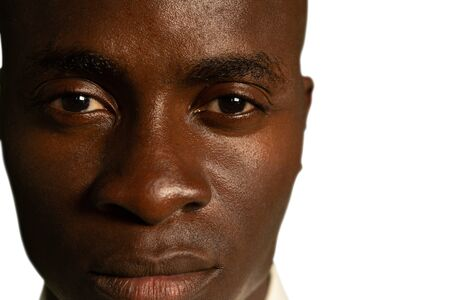 Head shot of a young African American man looking to straight to camera